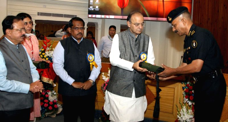 Union Minister for Finance, Corporate Affairs and Defence Arun Jaitley hands over the 'OTL-300' to the DG, NSG Sudhir Pratap Singh, in New Delhi on May 1, 2017. Also seen Minister of State ... - Arun Jaitley and Sudhir Pratap Singh