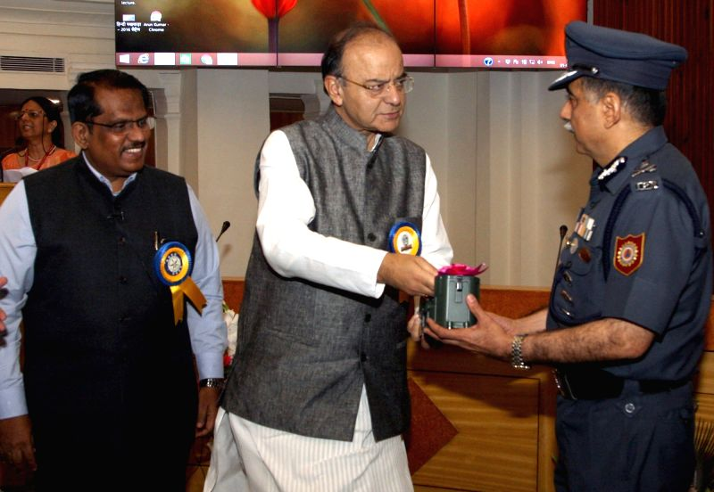 Union Minister for Finance, Corporate Affairs and Defence Arun Jaitley hands over the 'E-Nasika' to the DG, NDRF RK Pachnanda in New Delhi on May 1, 2017. Also seen Chairman DRDO and ... - Arun Jaitley