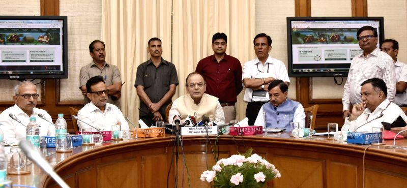 Union Minister for Finance, Corporate Affairs and Defence Arun Jaitley addresses at the launch of the new website 'Operation Clean Money' in New Delhi on May 16, 2017. Also seen Revenue ... - Arun Jaitley
