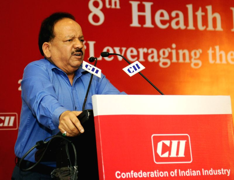 Union Minister for Health and Family Welfare, Dr. Harsh Vardhan addresses at the `8th Health Insurance Summit 2014` organised by the Confederation of Indian Industry (CII), in New Delhi on August 27,