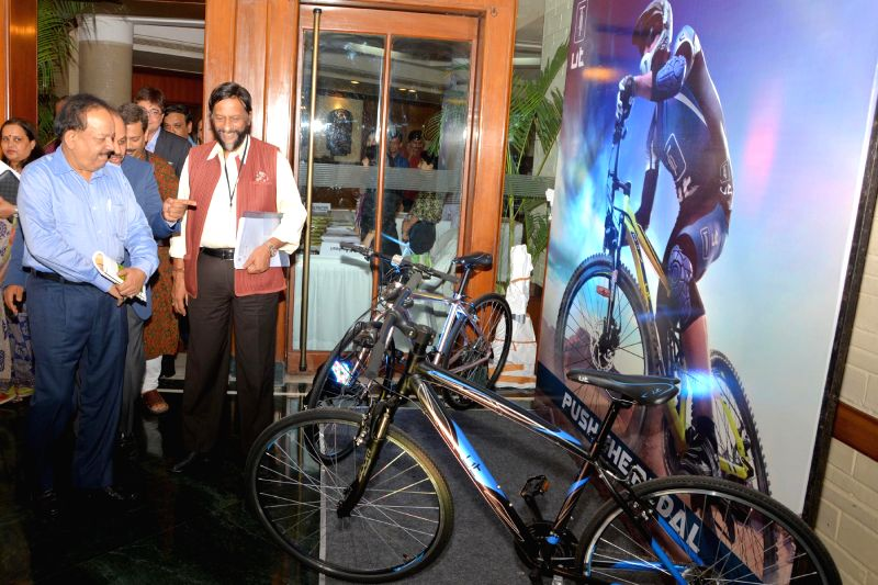 Union Minister for Health and Family Welfare Dr. Harsh Vardhan looks at a cycle during the release of a study report titled `Peddling towards a Greener India: A Report on Promoting Cycling in the ...
