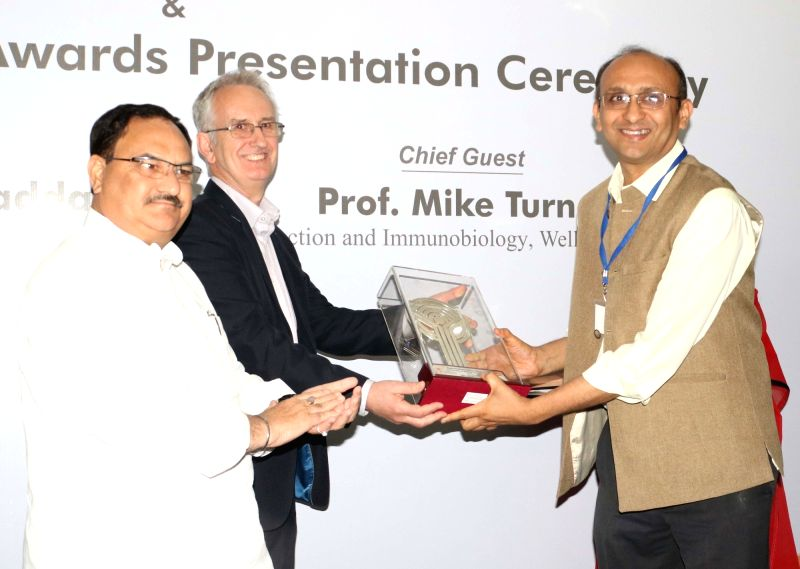 Union Minister for Health and Family Welfare JP Nadda with UK Welcome Trust's head of Infection & Immunobilogy Prof. Mike Turner distribute Sun Pharma Research award to PhD Professors ...