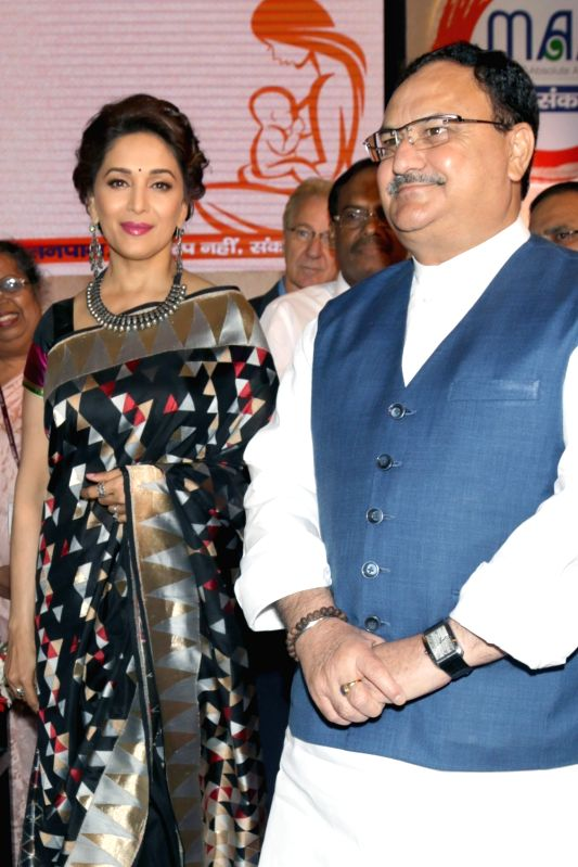"Union Minister for Health & Family Welfare JP Nadda at the launch of the ""MAA- Mother's Absolute Affection"" a nationwide programme to promote breastfeeding, in New Delhi on ... - Madhuri Dixit Nene"
