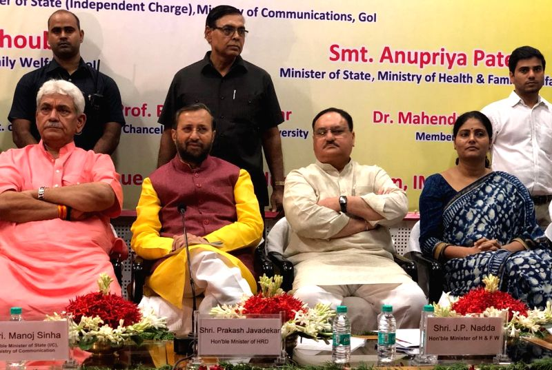 Union Minister for Health & Family Welfare JP Nadda and Union Minister for Human Resource Development Prakash Javadekar witness the MoU exchange ceremony between AIIMS New Delhi and ... - Manoj Sinha and Welfare Anupriya Patel