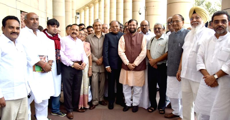 Union Minister for Human Resource Development Prakash Javadekar felicitate the MPs who are from Academic background, on the occasion of Guru Purnima, at Parliament House, in New Delhi on ...