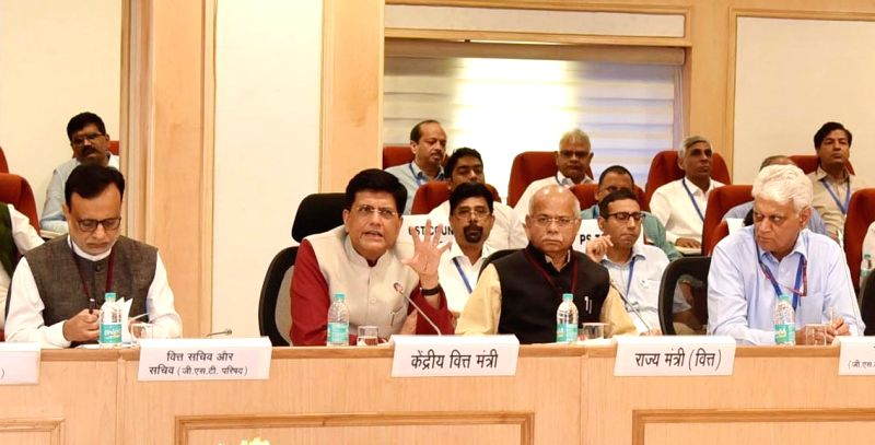 Union Minister for Railways, Coal, Finance and Corporate Affairs Piyush Goyal chairs the 29th GST Council meeting in New Delhi on Aug 4, 2018. Also seen MoS for Finance Shiv Pratap Shukla ...