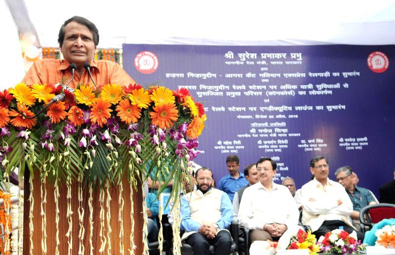 Union Minister for Railways Suresh Prabhakar Prabhu flagging off the India`s first semi-high speed train christened as 'Gatimaan Express', between H. Nizammuddin station and Agra ... - Suresh Prabhakar Prabhu