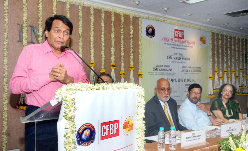Union Minister for Railways Suresh Prabhu addresses at the 29th CFBP Jamnalal Bajaj award function in Mumbai on April 18, 2017. Also seen Minister for Food and Drugs of Maharashtra Girish ... - Suresh Prabhu