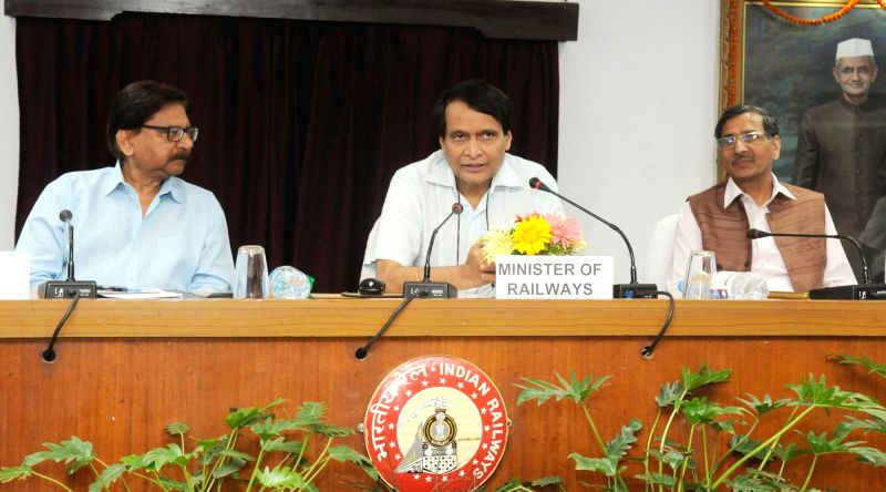 Union Minister for Railways Suresh Prabhu addresses at the flag-off of the New Trains and dedication of New Freight Terminals, through video conferencing from Rail Bhavan, in New Delhi on ... - Suresh Prabhu