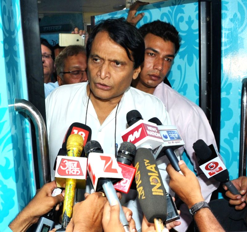 Union Minister for Railways Suresh Prabhu interacts with the media after inspecting the rake of Humsafar Train with added features at Safdarjung Railway Station in New Delhi on June 14, ... - Suresh Prabhu