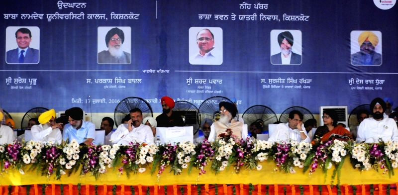 Union Minister for Railways Suresh Prabhu and Punjab Chief Minster Parkash Singh Badal during the inauguration of Bhagat Namdev University College at Ghuman in Gurdaspur district of Punjab ... - Suresh Prabhu
