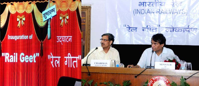 "Union Minister for Railways Suresh Prabhu launch the ""Rail Geet"" during a programme in New Delhi on Aug 5, 2016. Also seen Railway Board Chairman AK Mital. - Suresh Prabhu"