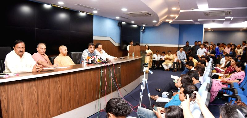 Union Minister for Road Transport & Highways, Shipping and Water Resources, River Development & Ganga Rejuvenation Nitin Gadkari addresses a press conference after chairing a high ... - Yogi Adityanath, Mahesh Sharma and Satya Pal Singh