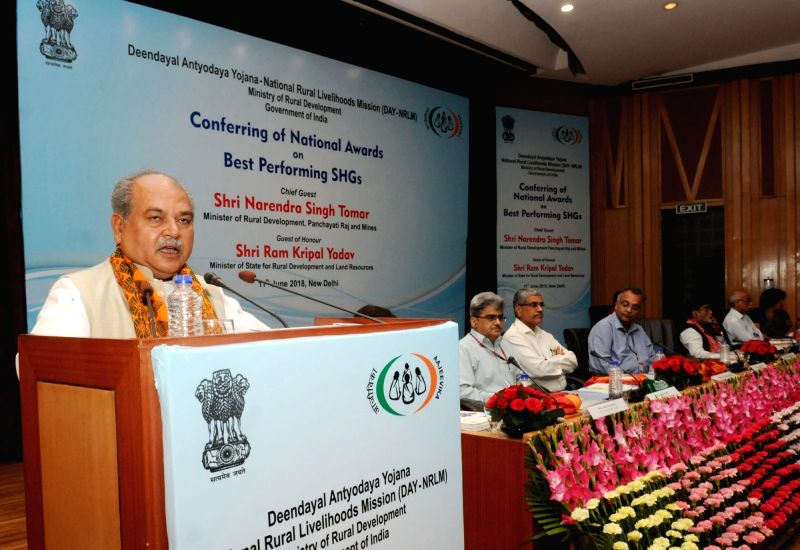 Union Minister for Rural Development and Panchayati Raj minister Narendra Singh Tomar addresses during a programme organised to confer the National Awards on the Best Performing Self Help ... - Narendra Singh Tomar