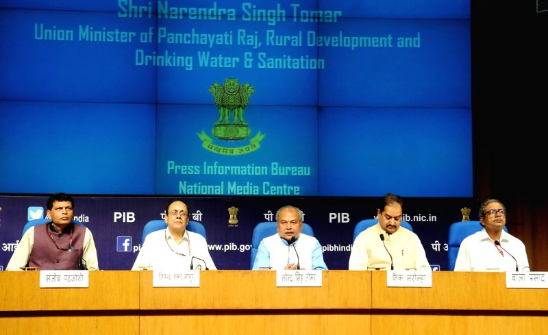 Union Minister for Rural Development, Panchayati Raj, Drinking Water and Sanitation Narendra Singh Tomar addresses a press conference on the National Panchayati Raj Day, in New Delhi on ... - Narendra Singh Tomar