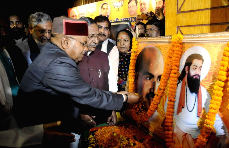 Union Minister for Social Justice and Empowerment Thaawar Chand Gehlot pays tribute to the portrait of Guru Ravidas on his Jayanti in Patna on Jan 31, 2018. Also seen Bihar Deputy Chief ... - Sushil Kumar Modi