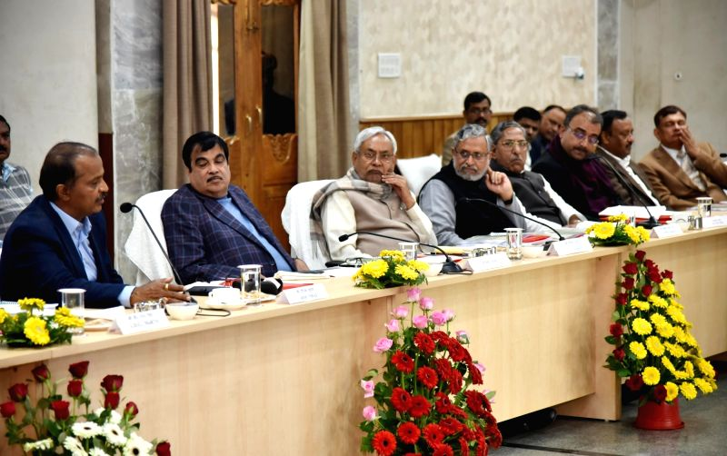 Union Minister for Transport and Shipping Nitin Gadkari, Bihar Chief Minister Nitish Kumar and Deputy Chief Minister Sushil Kumar Modi during a review meeting related to National highway road ... - Nitish Kumar and Sushil Kumar Modi