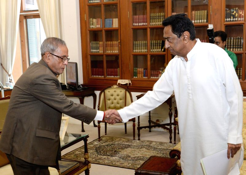 Union Minister for Urban Development and Parliamentary Affairs Kamal Nath during a meeting with President Pranab Mukherjee at Rashtrapati Bhavan in New Delhi on May 17, 2014. - Affairs Kamal Nath