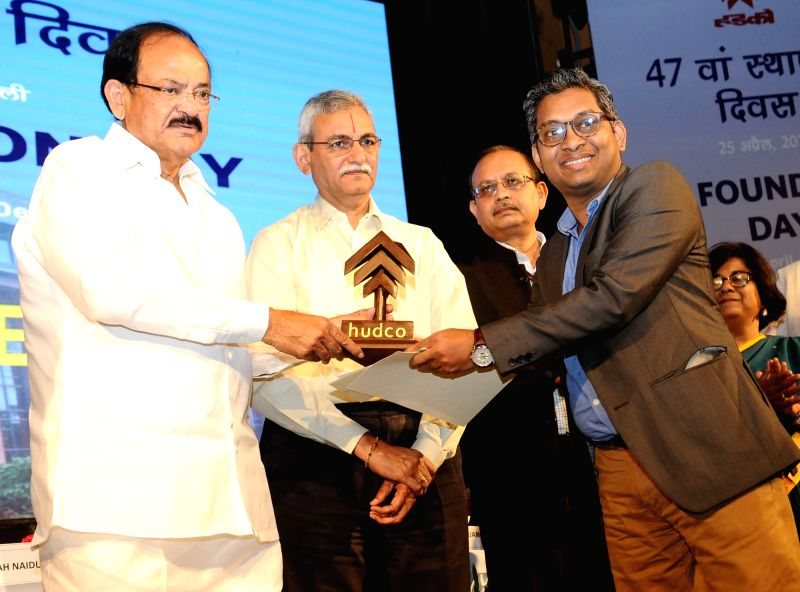 Union Minister for Urban Development, Housing & Urban Poverty Alleviation and Information & Broadcasting M Venkaiah Naidu presents an award at the 47th Foundation day function of ... - M Venkaiah Naidu