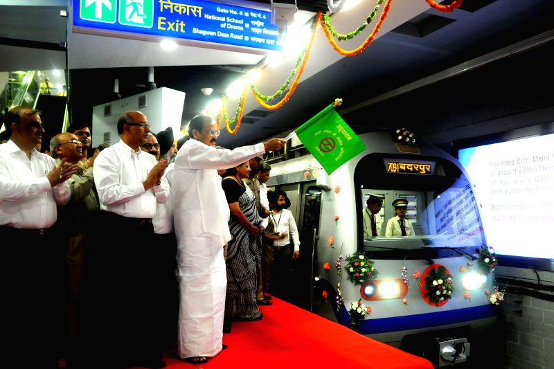 Union Minister for Urban Development, Housing and Urban Poverty Alleviation and Parliamentary Affairs M. Venkaiah Naidu flags off a train to inaugurate Delhi Metro's much-awaited Mandi House to ... - M. Venkaiah Naidu