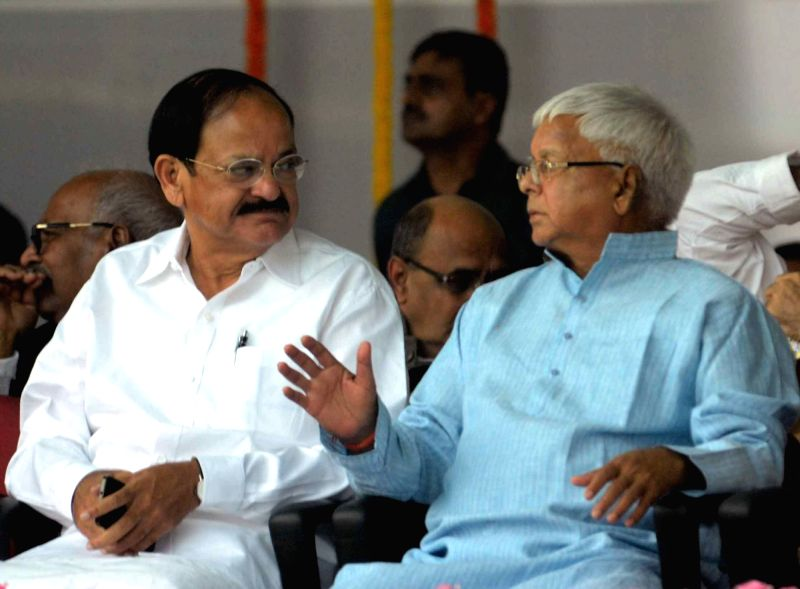 Union Minister for Urban Development, Housing and Urban Poverty Alleviation and Parliamentary Affairs M. Venkaiah Naidu and RJD chief Lalu Prasad Yadav during the swearing-in ceremony of the ... - M. Venkaiah Naidu and Lalu Prasad Yadav