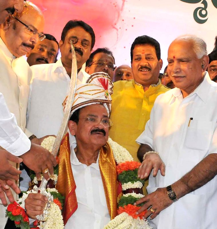 Union Minister for Urban Development, Housing and Urban Poverty Alleviation and and Information and Broadcasting M. Venkaiah Naidu and party leader BS Yeddyurappa during a BJP programme in ... - M. Venkaiah Naidu
