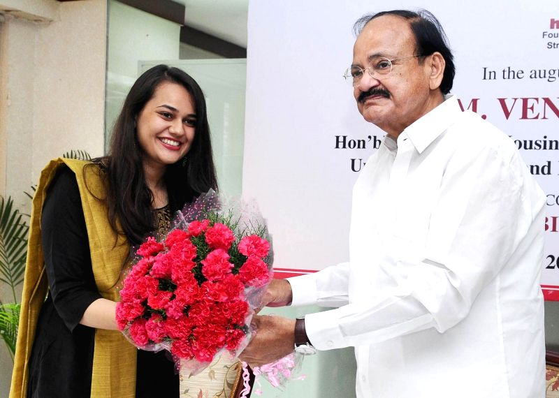 Union Minister for Urban Development, Housing and Urban Poverty Alleviation and Information and Broadcasting, M Venkaiah Naidu felicitate Tina Dabi, IAS topper (2016), on behalf of HUDCO ... - M Venkaiah Naidu