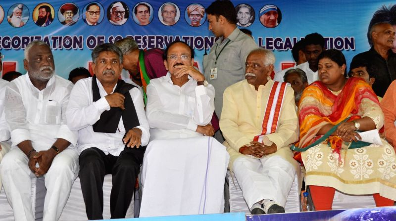 Union Minister for Urban Development, Housing and Urban Poverty Alleviation and and Information and Broadcasting M. Venkaiah Naidu, and Union MoS Labour Bandaru Dattatreya during a Madiga ... - M. Venkaiah Naidu