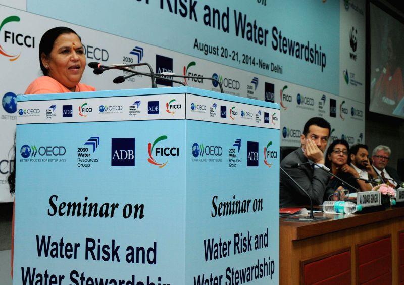 Union Minister for Water Resources, River Development and Ganga Rejuvenation Uma Bharati addresses at the `International Seminar on Water Risk and Stewardship` in New Delhi on August 20, 2014.