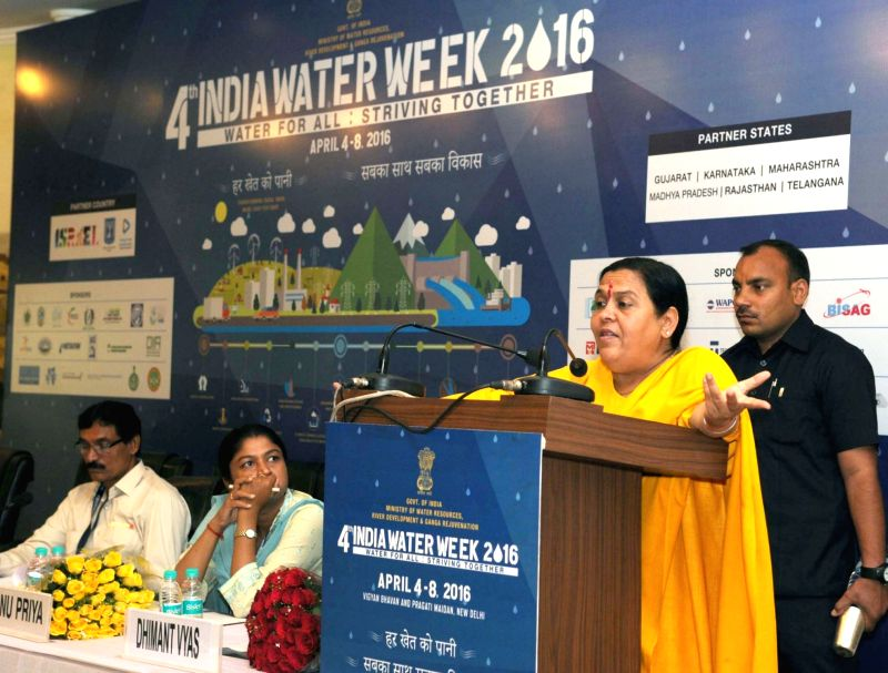 """Union Minister for Water Resources, River Development and Ganga Rejuvenation Uma Bharti addresses during a special session on """"Community Participation in Water Resources"""" organised as ..."""