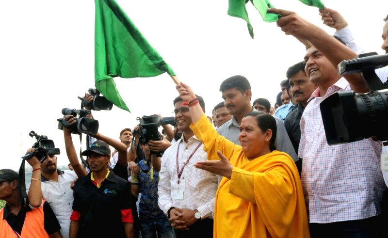 Union Minister for Water Resources, River Development and Ganga Rejuvenation Uma Bharti and Delhi Tourism and Water minister Kapil Mishra flagg off a trash skimmer boat for Yamuna river in ... - Kapil Mishra
