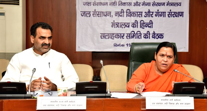 Union Minister for Water Resources, River Development and Ganga Rejuvenation Uma Bharti chairs a meeting of Rajbhasha Salahkar Samiti, in New Delhi on July 19, 2016. Also seen the Minister ... - Sanjeev Kumar Balyan
