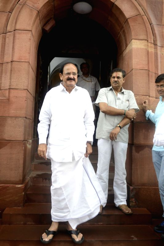 Union Minister M. Venkaiah Naidu and BJP MP Kirti Azad at Parliament in New Delhi, on July 25, 2016. - M. Venkaiah Naidu