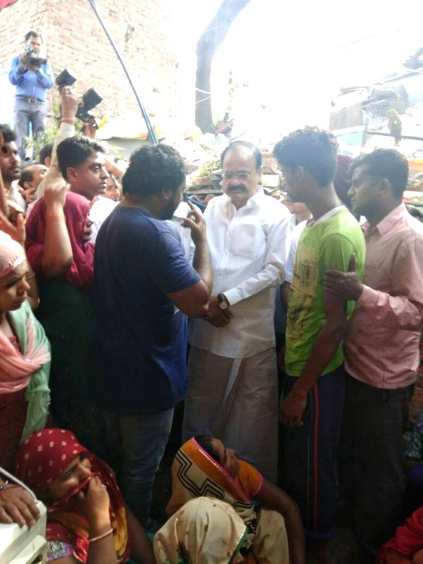 """Union Minister M Venkaiah Naidu visits the family of the deceased e-rickshaw driver, who was lynched for trying to stop people from urinating in public and promoting """"Swachh Bharat ... - M Venkaiah Naidu and Ravinder Kumar"""