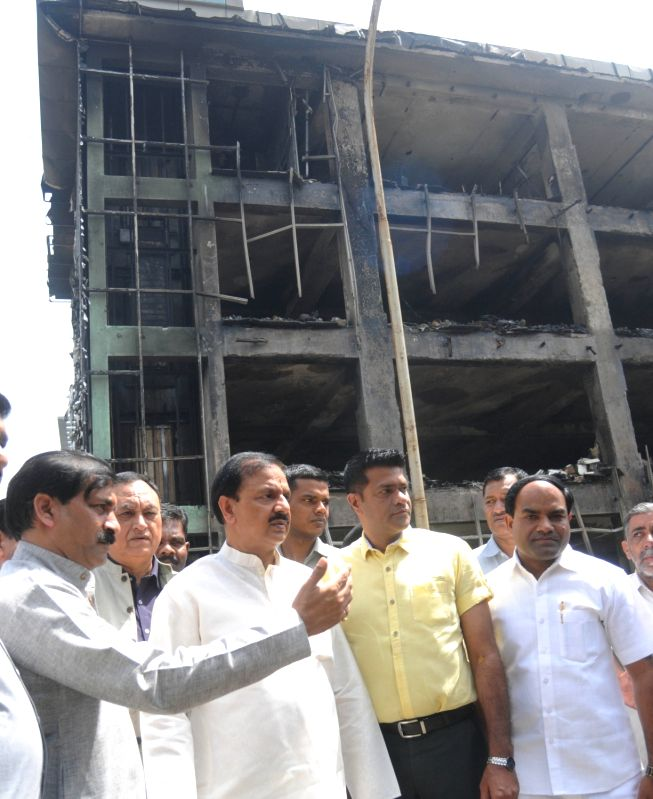 Union Minister Mahesh Sharma visits the electronics factory building where a massive fire broke out killing six persons on 19th April, 2017; in in Noida on April 20, 2017. - Mahesh Sharma