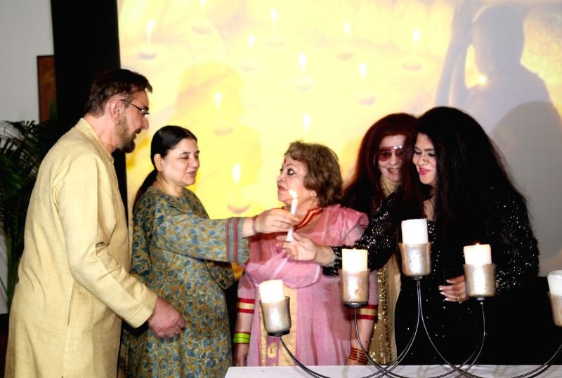 Union Minister Maneka Gandhi, Actor Kabir Bedi, Salma Ansari, wife of Vice-President Mohammad Hamid Ansari, beauty expert Shahnaz Husain and others at the launch of entrepreneur Nilofer ... - Maneka Gandhi and Kabir Bedi