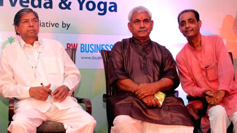Union Minister Manoj Sinha lighting the ceremonial lamp to inaugurate India's first Ayurveda festival organised by World Ayurveda Foundation and NirogStreet.com in New Delhi on May 6, ... - Manoj Sinha