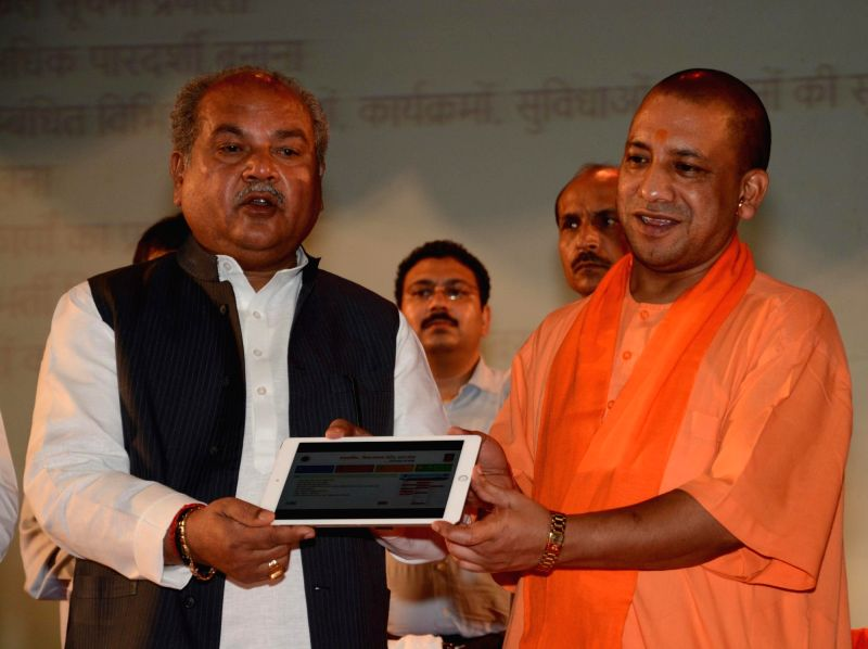 Union Minister Narendra Singh Tomar and Uttar Pradesh Chief Minister Yogi Adityanath during a programme in Dr. Ram Manohar Lohiya National Law University in Lucknow on April 24, 2017. - Narendra Singh Tomar