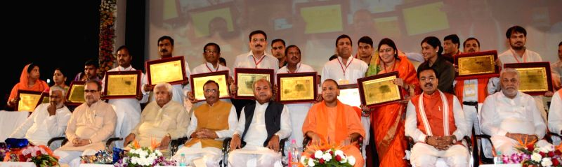 Union Minister Narendra Singh Tomar, Uttar Pradesh Chief Minister Yogi Adityanath, Deputy Chief Minister Keshav Prasad Maurya and  others during a programme in Dr. Ram Manohar Lohiya ... - Narendra Singh Tomar