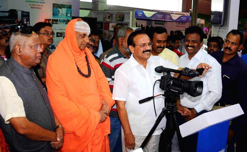 Union Minister of Law and Justice DV Sadananda Gowda with Sri Shivarathri Deshikendra Mahaswamiji during the inauguration of ``Photo Today-2015`` at Peenya organised by Karnataka Video and ...