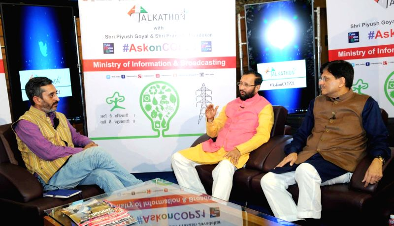 Union Minister of State for Environment, Forest and Climate Change (Independent Charge), Prakash Javadekar and the Minister of State (Independent Charge) for Power, Coal and New and ...