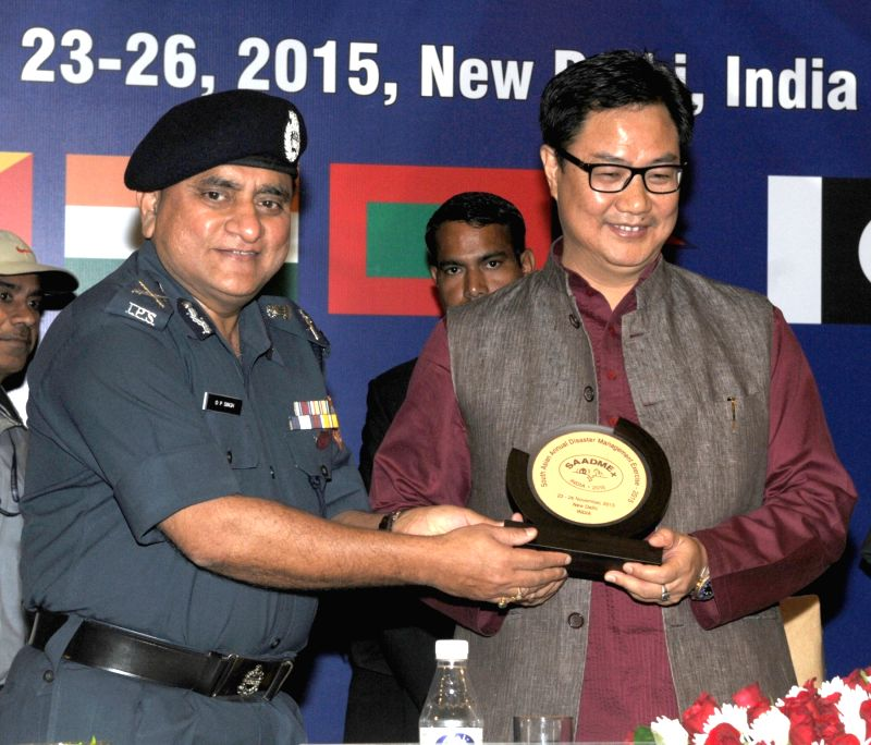 Union Minister of State for Home Affairs, Kiren Rijiju being presented a memento by the Director General, National Disaster Response Force (NDRF),  O.P. Singh, at the inauguration of the ... - P. Singh