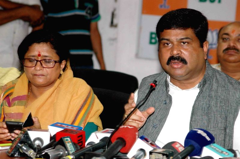 Union Minister of State for Petroleum and Natural Gas Dharmendra Pradhan addresses a press conference in Patna, on July 23, 2015.