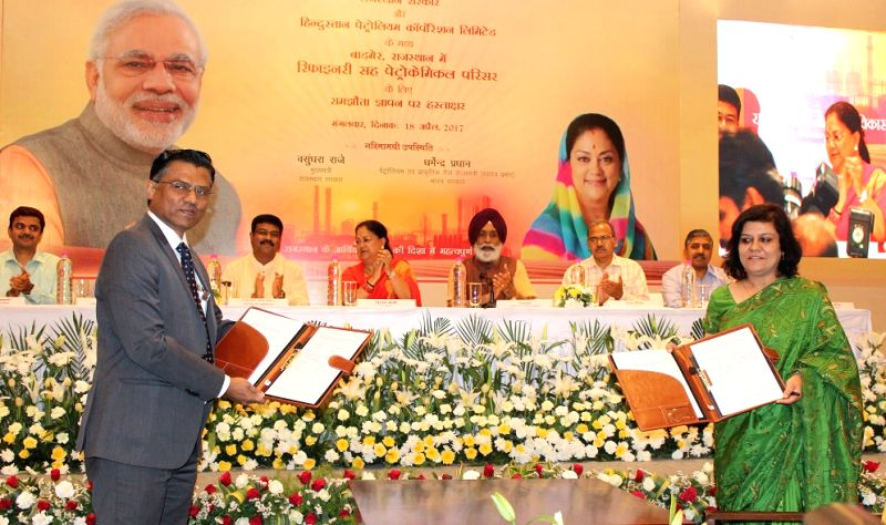 Union Minister of State for Petroleum and Natural Gas (Independent Charge) Dharmendra Pradhan and Rajasthan Chief Minister Vasundhara Raje Scindia witness the signing ceremony of an MoU ... - Vasundhara Raje Scindia