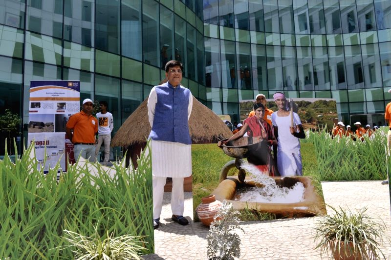 Union Minister of State for Power, Coal, New & Renewable Energy & Mines, Piyush Goyal looks at an artificial village created before the start of press conference on Deendayal ...