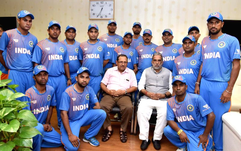 Union Minister of State for Social Justice and Empowerment Krishan Pal with the physically challenged cricketer team going to Afghanistan, in New Delhi on July 19, 2016. Also seen the ...