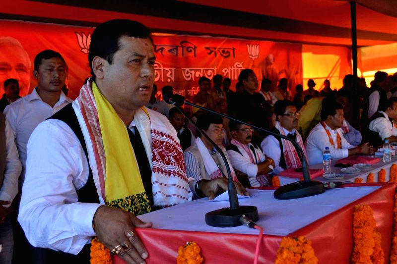 Union Minister of State for Sports and Youth Welfare and Assam BJP  chief  Sarbananda Sonowal addresses during a party programme in Lakhimpur district of Assam on Nov 23, 2015.