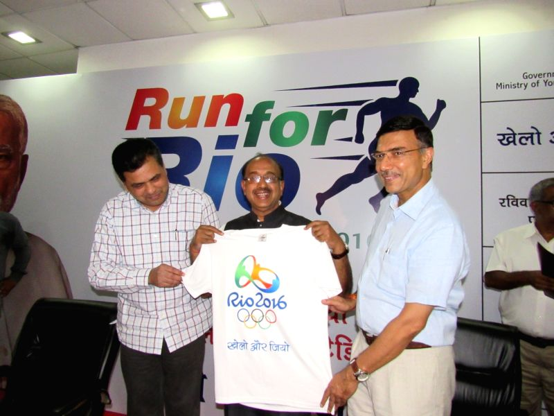 Union Minister of State for Youth Affairs and Sports Vijay Goel during a press conference on 'Run for Rio Olympics', in New Delhi on July 25, 2016. Also seen the Secretary, Ministry of ... - Rajiv Yadav