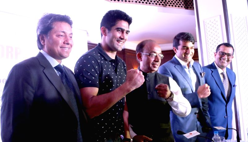 "Union minister of state for Youth and Sports, Vijay Goel, Indian pro Boxer Vijender Singh, addressing a program on ""Olympics & Role of corporate India"" in New Delhi, on July ... - Vijender Singh"