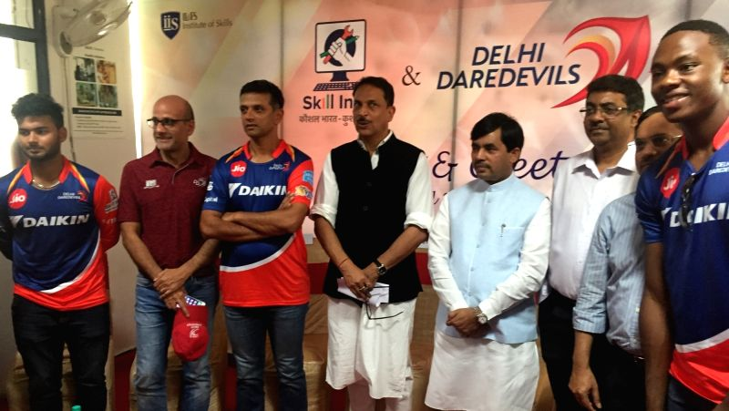 Union Minister of State (I/C) for Skill Development and Entrepreneurship Rajiv Pratap Rudy and Delhi Daredevil coach Rahul Dravid during Meet and Greet programme to felicitate several ... - Rahul Dravid